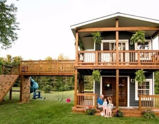 This Dad Built His Daughters the 2-Story Playhouse of Their Dreams and It's Bigger Than My Whole Apartment