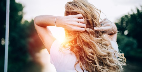 4 Products Guaranteed to Save Your Hair From the Sun and Sand This Summer
