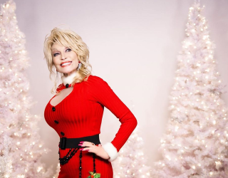 While We're All Getting Tricky, Dolly Parton Is Handing out Christmas Treats