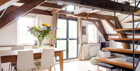 9 of the Coolest Airbnbs in Amsterdam That Will Go Perfectly With a Stroopwafel