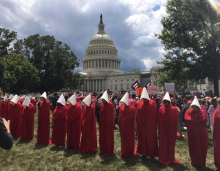 Photos of the Week: Handmaids in Washington and Canada Day