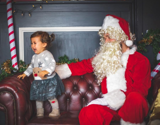 10 Photos of Kids With Santa That Aren't Funny...but Are