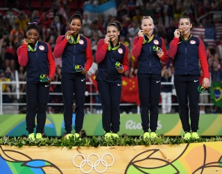Could You Qualify for Olympic Gymnastics? There Are a Lot of Hoops to Flip Through