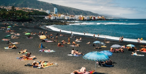 Travel Tuesday: You Can Still Squeeze a Black Sand Beach Day In This Summer