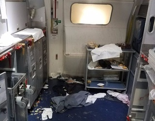 A Flight Attendant Subdued an out of Control Passenger With a Bottle of Red Wine on a Delta Flight
