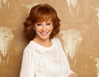 Get on Reba McEntire's Good Side and Successfully Match the Lyric to Her Single