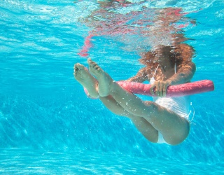 How to Get a Challenging and Engaging Workout in From Your Backyard Swimming Pool