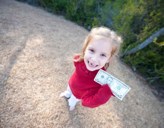 Who's Responsible for the Tooth Fairy, AKA Your Kids' First ATM?