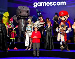 Check out Angela Merkel, Leader of the Free World, Playing Video Games With Cosplayers