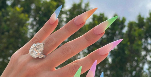 Khloé Kardashian Is Trying to Act Not Engaged Despite Flashing This Monster Ring All Over Instagram